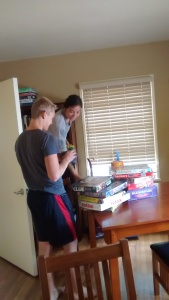 Eric and Bianca dust the book shelves